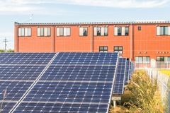 Solar power panels ,Photovoltaic modules for innovation green e. Nergy for life with blue sky background Stock Photo