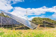 Solar power panels ,Photovoltaic modules for innovation green e. Nergy for life with blue sky background Stock Photos