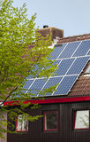 Solar power panels on roof of a house Stock Photos