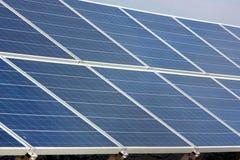 Solar power plant. Solar power panels isolated on a sky background Stock Photos