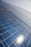 Solar power plant. Panels with sun reflection Stock Image
