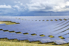 Solar power plant. Field of photovoltaic panels of a big solar energy power plant Royalty Free Stock Photos