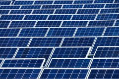 Solar power plant. Many rows of large solar panels in a power plant Royalty Free Stock Photos