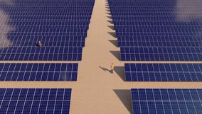Solar power plant and two worker walking around royalty free stock photo