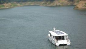 Solar-power pleasure boat. Solar-power pleasure boat in the Matilda reservoir, Miaoli,Taiwan stock photo