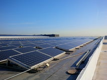 Solar power rooftop. Rows of solar panels on a roof Stock Images