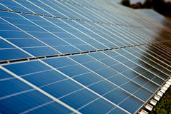 Solar power station. Soft-focus closeup view on solar panels royalty free stock image