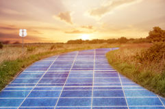 Solar power station in blue sky on the road Royalty Free Stock Photo