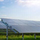 Solar power station in a field. Solar power station in a green field Royalty Free Stock Images