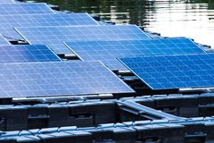 Solar power station float on water. Ecological energy renewable solar panel plant electric power royalty free stock photo