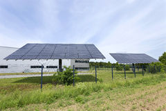 Solar Power Station on the green Meadow Royalty Free Stock Image