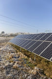 Solar Power Station in the snowy freeze winter Nature Royalty Free Stock Image