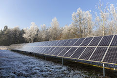 Solar Power Station in the snowy freeze winter Nature Stock Image