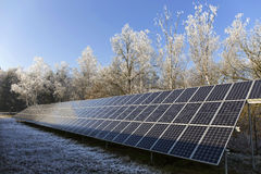 Solar Power Station in the snowy freeze winter Nature Royalty Free Stock Photography