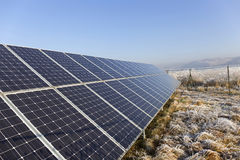 Solar Power Station in the snowy freeze winter Nature Royalty Free Stock Photos