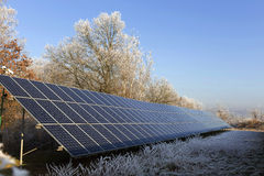 Solar Power Station in the snowy freeze winter Nature Royalty Free Stock Photo