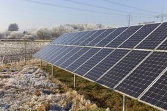 Solar Power Station in the snowy freeze winter Nature Stock Images