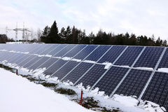 Solar Power Station in the snowy winter Nature Stock Image