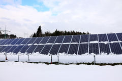 Solar Power Station in the snowy winter Nature Royalty Free Stock Photo
