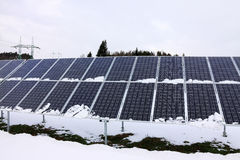 Solar Power Station in the snowy winter Nature Royalty Free Stock Photos