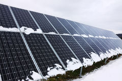 Solar Power Station in the snowy winter Nature Royalty Free Stock Image