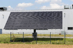 Solar Power Station on the spring flowering Meadow Royalty Free Stock Images