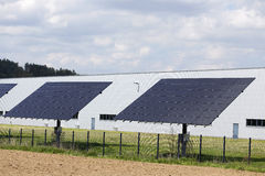 Solar Power Station on the spring flowering Meadow Royalty Free Stock Photo