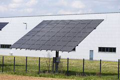 Solar Power Station on the spring flowering Meadow Royalty Free Stock Photography