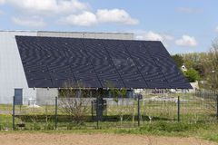 Solar Power Station on the spring flowering Meadow Royalty Free Stock Photos