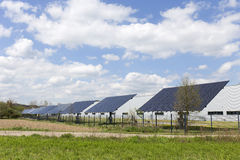 Solar Power Station on the spring flowering Meadow Stock Photo