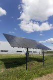 Solar Power Station on the spring flowering Meadow in the sunny Day Stock Photography