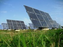 Solar power system group. On green meadow Stock Photo