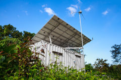 Solar power and wind turbine generator.  Green energy concept. Royalty Free Stock Photography