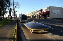 Solar-powered car. CENTRALIA, WASHINGTON — JANUARY 20, 2009 — A solar-powered car zips down an ordinary street Stock Photography