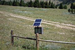 Solar powered electric fence in the mountains Stock Images