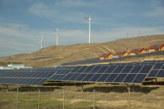 Solar-powered electricity system . Solar panel, photovoltaic, alternative electricity source . Wind farm: Industrial Eolic install stock photos
