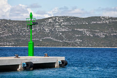 Solar powered green lighthouse in the Adriatic sea Stock Photos