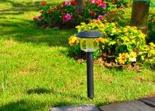 Solar-powered lamp. On garden background royalty free stock photos