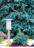Solar Powered Lamp on Garden Background. Stock Photo
