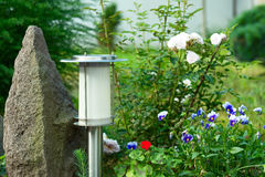 Solar Powered Lamp on Garden Background. Stock Photography