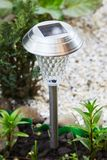 A solar-powered lamp in the garden stock photography