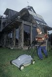 Solar powered lawnmower at an energy efficient home in Mendocino, CA Stock Photo