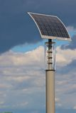 Solar powered light pole. With dramatic clouds Royalty Free Stock Photos