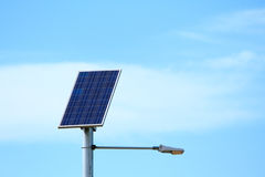 Solar powered lights. A solar powered street lights with blue sky background and white clouds Stock Photography