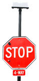 Solar Powered Stop Sign. A Stop Sign Equipped with Solar Power Stock Photos