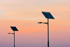 Solar powered street lights at sunset. Street lights powered by solar panels, at sunset Stock Photography