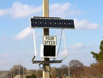 Solar Powered Traffic Speed Awareness Sign. This is a Solar powered traffic speed awareness sign located along a busy intersection Royalty Free Stock Photo