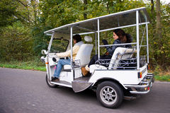 Solar powered tuc tuc on the road Royalty Free Stock Image