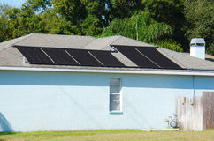 Solar powered water heating system on a house Stock Photo