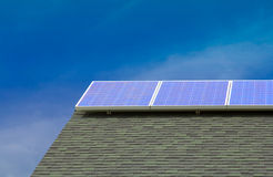 Solar PV panels on roof with Blue Sky Royalty Free Stock Photography